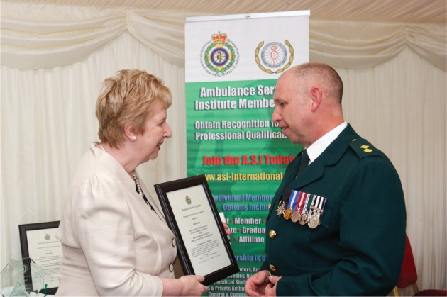 Paramedic Clive Parnham receives President's Commendation from Baroness Angela Browning. Photo Credit: Brian Aldrich